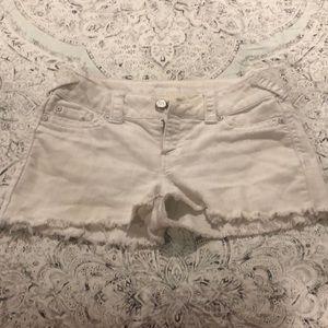White cutoff jean shorts